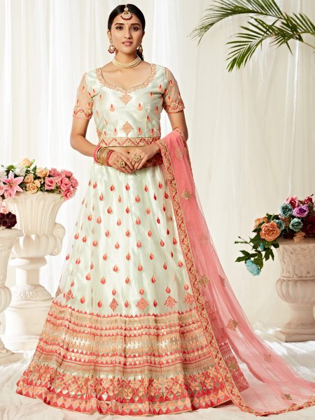 Tea Green and Coral Pink Net and Satin Silk Embroidered Wedding Lehenga Choli