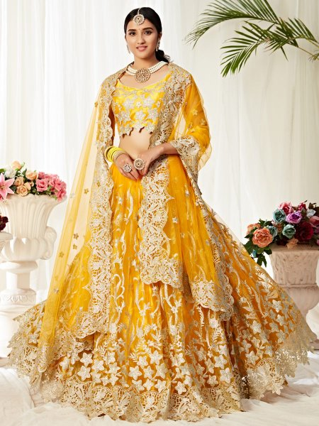 Amber Yellow Net and Satin Silk Embroidered Wedding Lehenga Choli